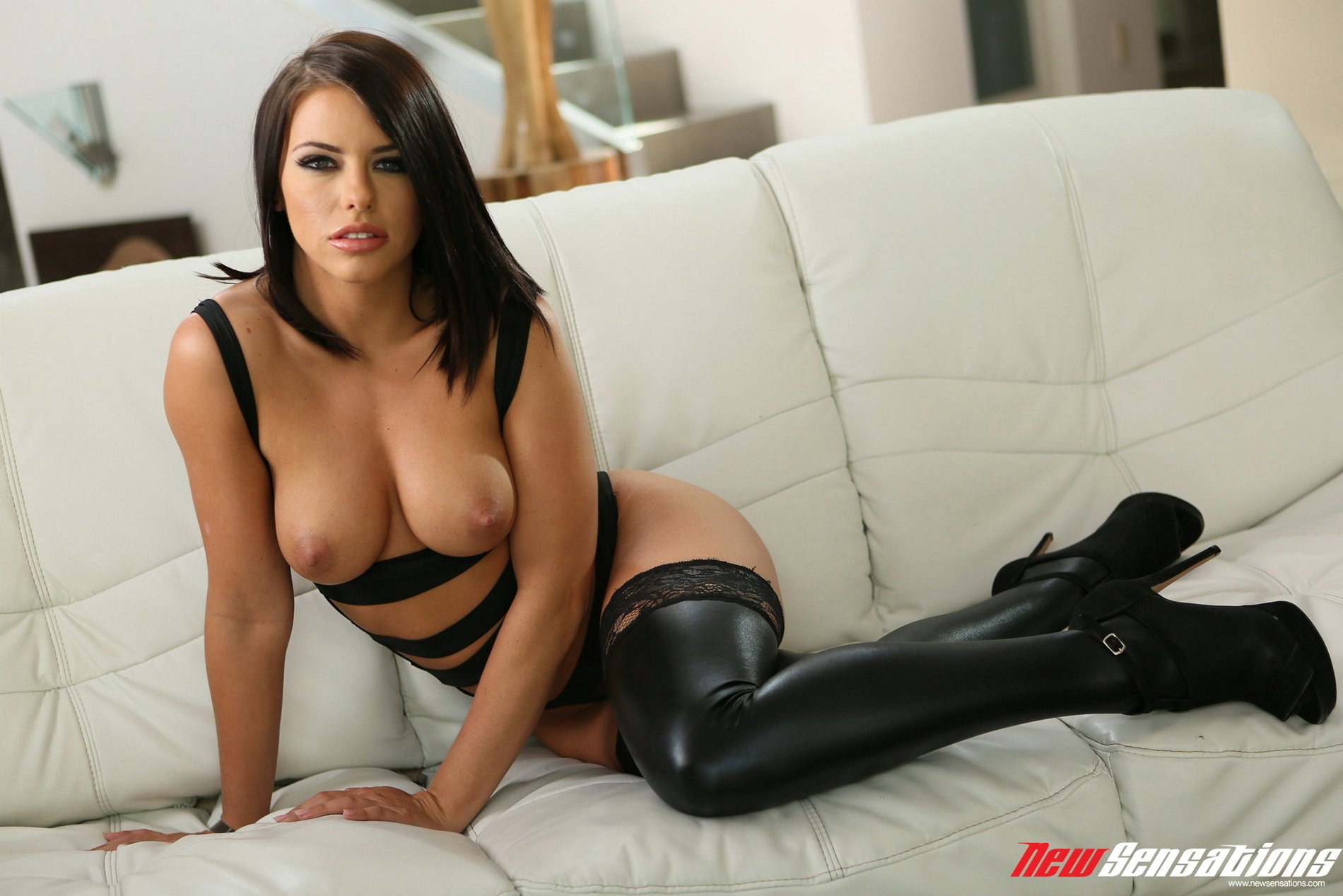 Leather Fetish Porn Stars - Adriana Chechik in black leather stockings and heels poses for camera.