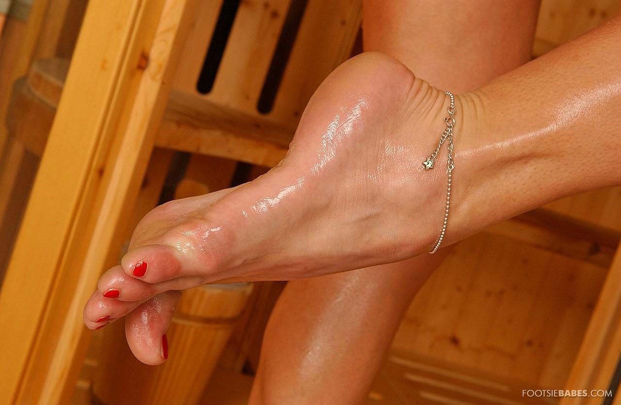 adriana malkova showing off her pretty feet in the sauna