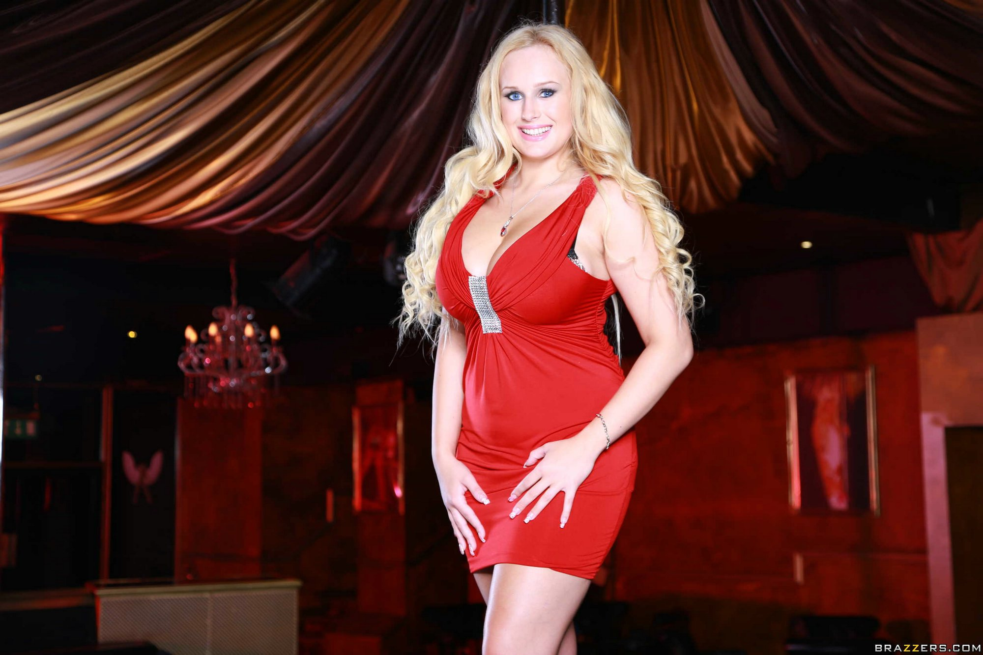 Busty dancer Angel Wicky posing in red dress and high ...