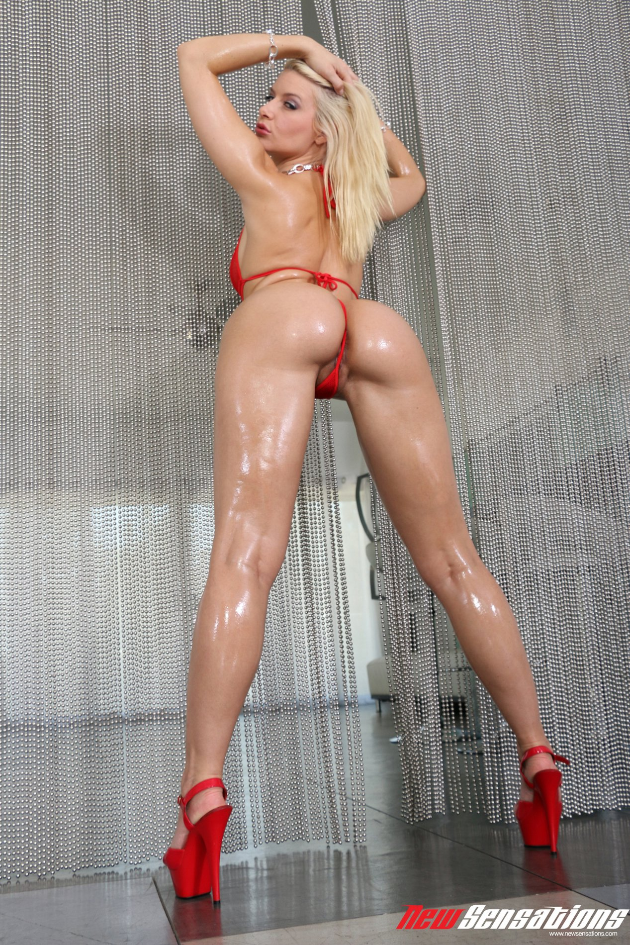 Anikka Albrite in red high heels shows off her oiled body ...