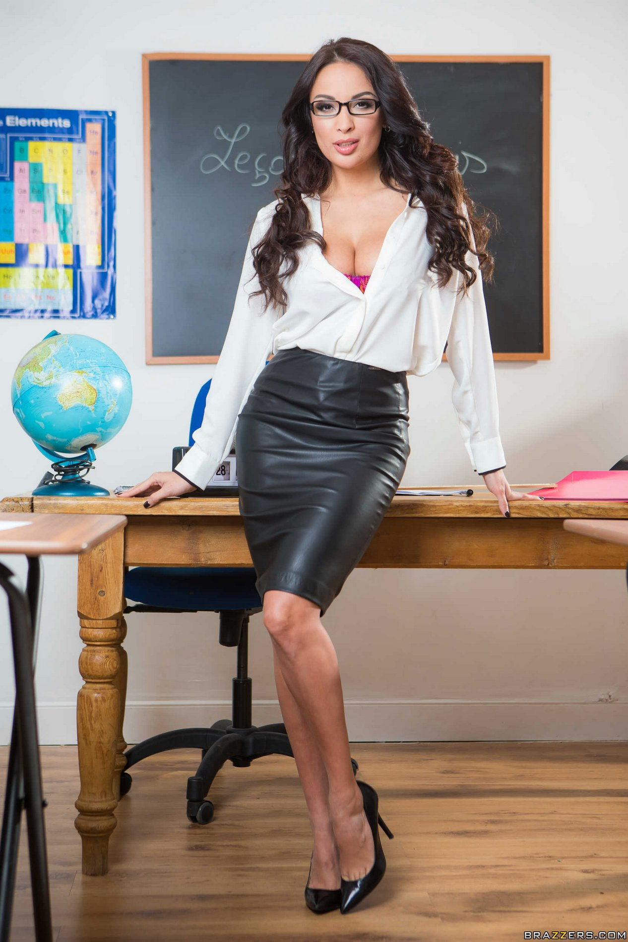 Hot young teacher in unbuttoned shirt sitting stock photo