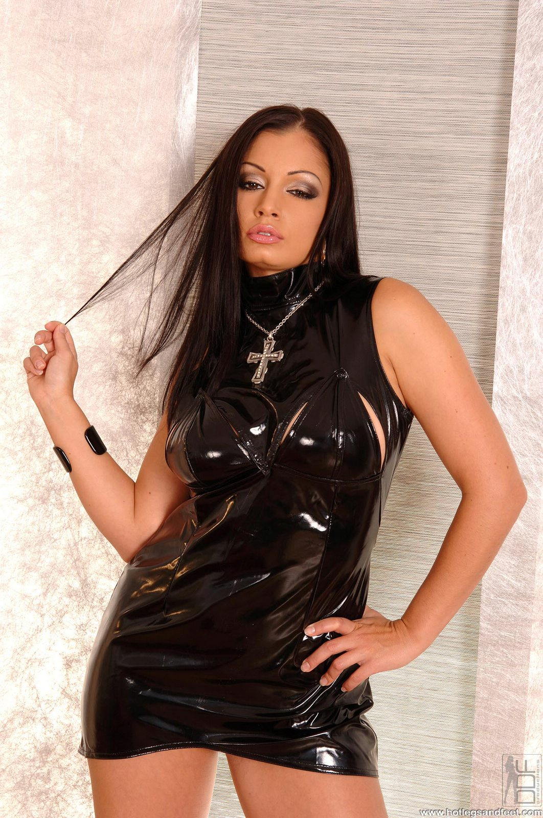 aria giovanni in sexy latex outfit showing off her legs