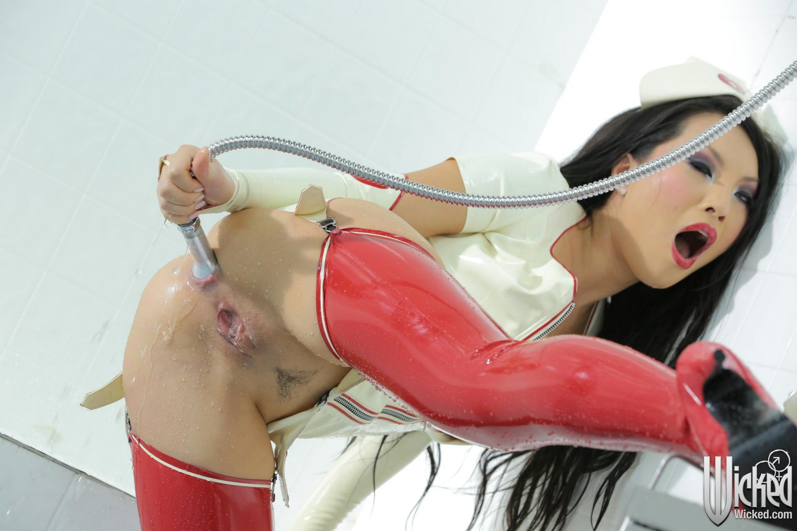 Blonde latex nurse fucking in gloves and stockings 7