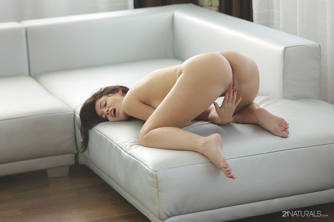 girl masturbates on couch