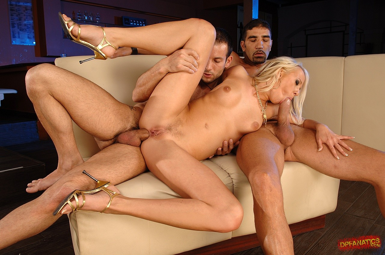 Sexy blonde Carla Cox fucking two huge dicks at once in ...