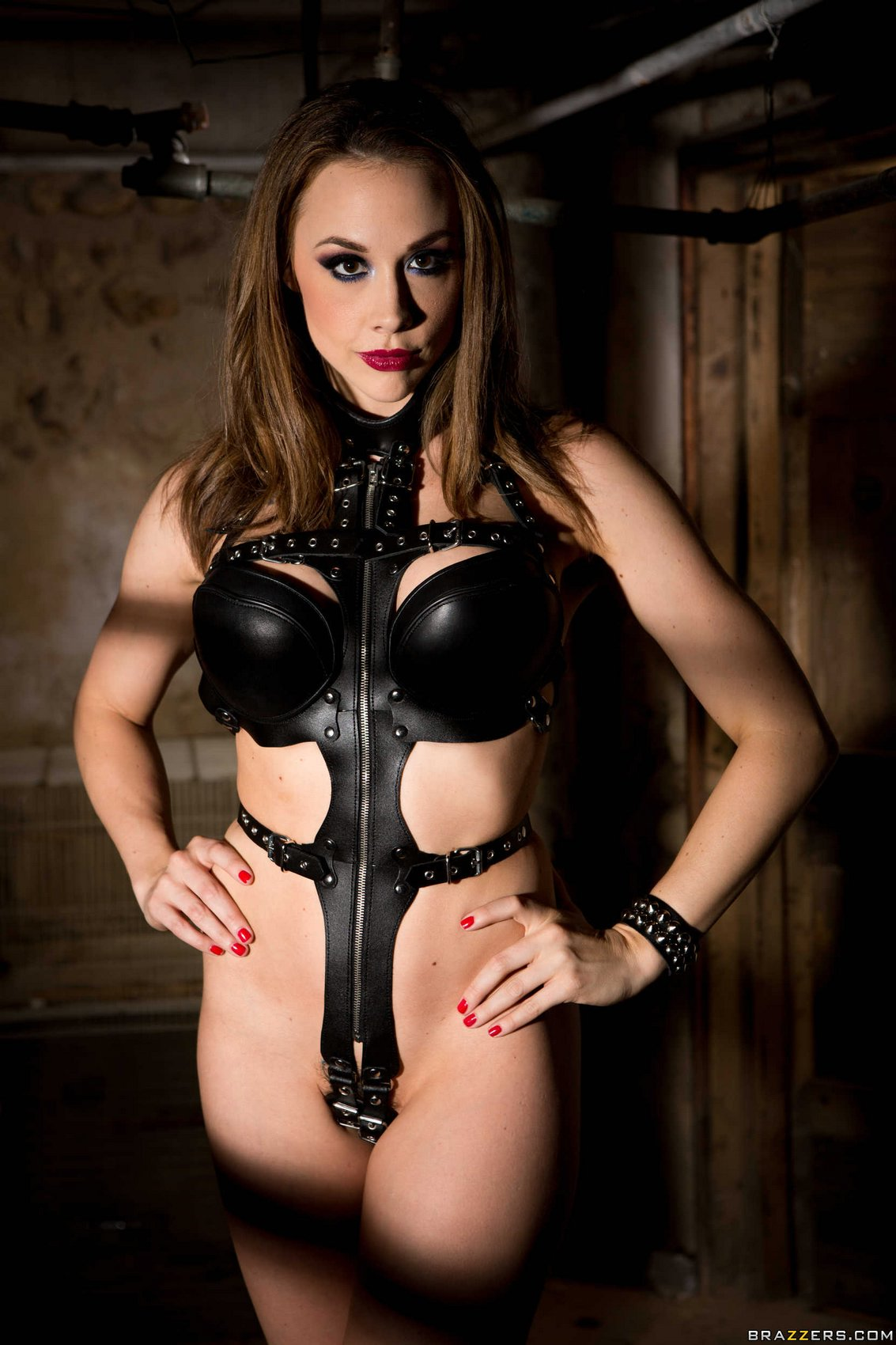 Mistress Chanel Preston in sexy high boots posing in front ...