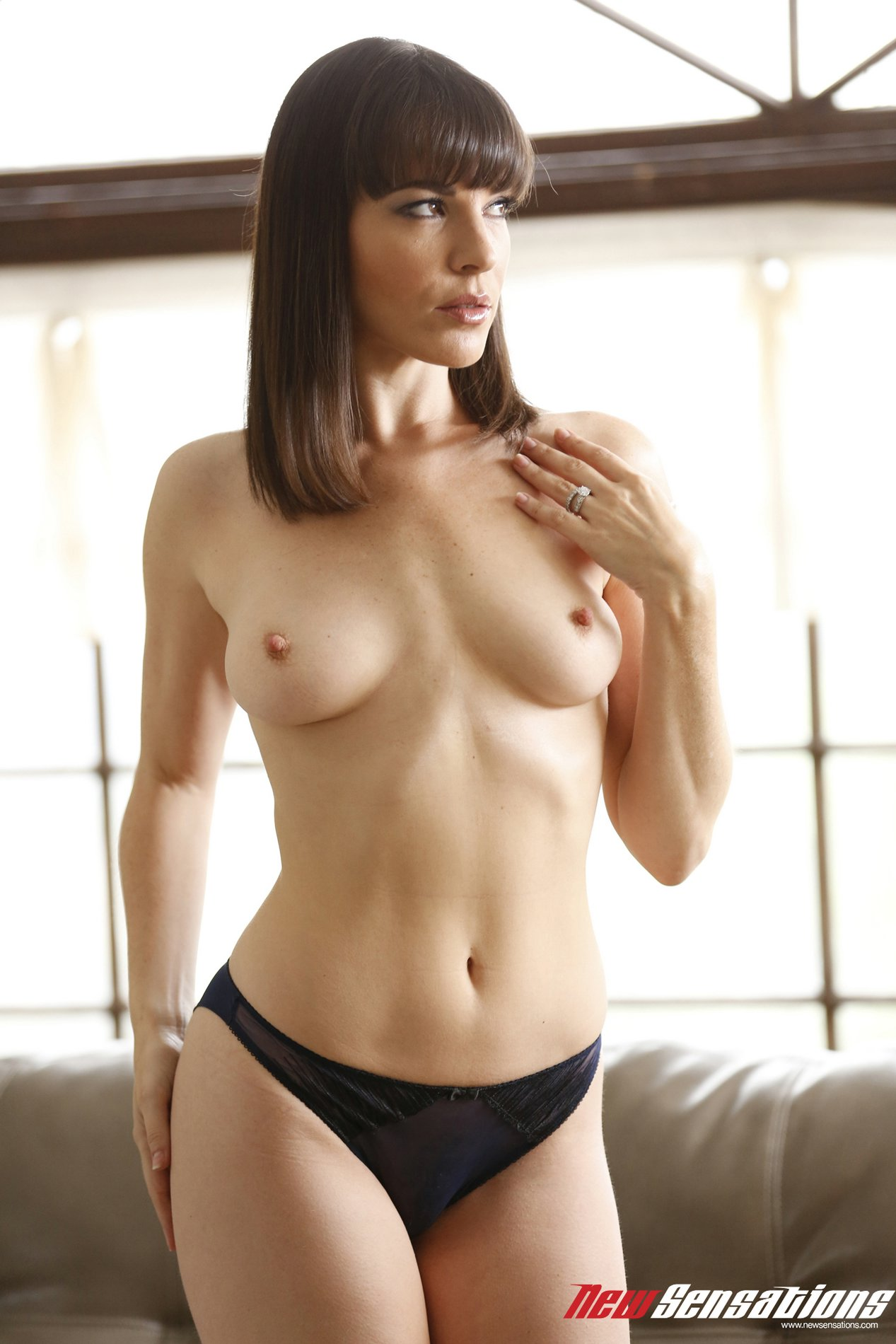 Dana DeArmond strips and poses naked on couch - My ...