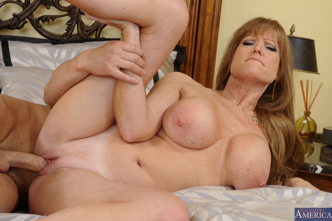The big titted milf darla crane enjoying black cock in mouth and also cunt
