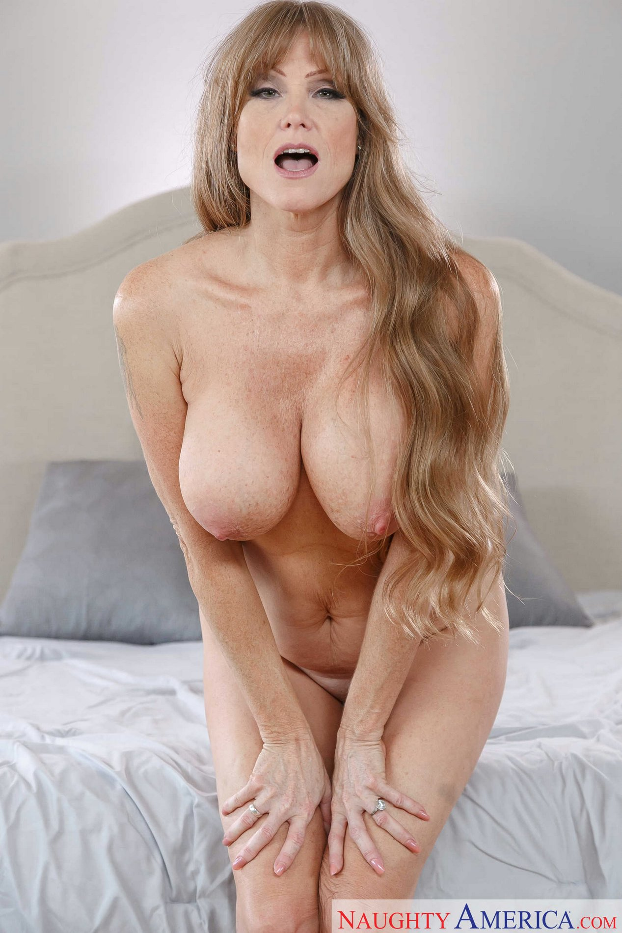 Gorgeous busty MILF Darla Crane strips and exhibits her ...
