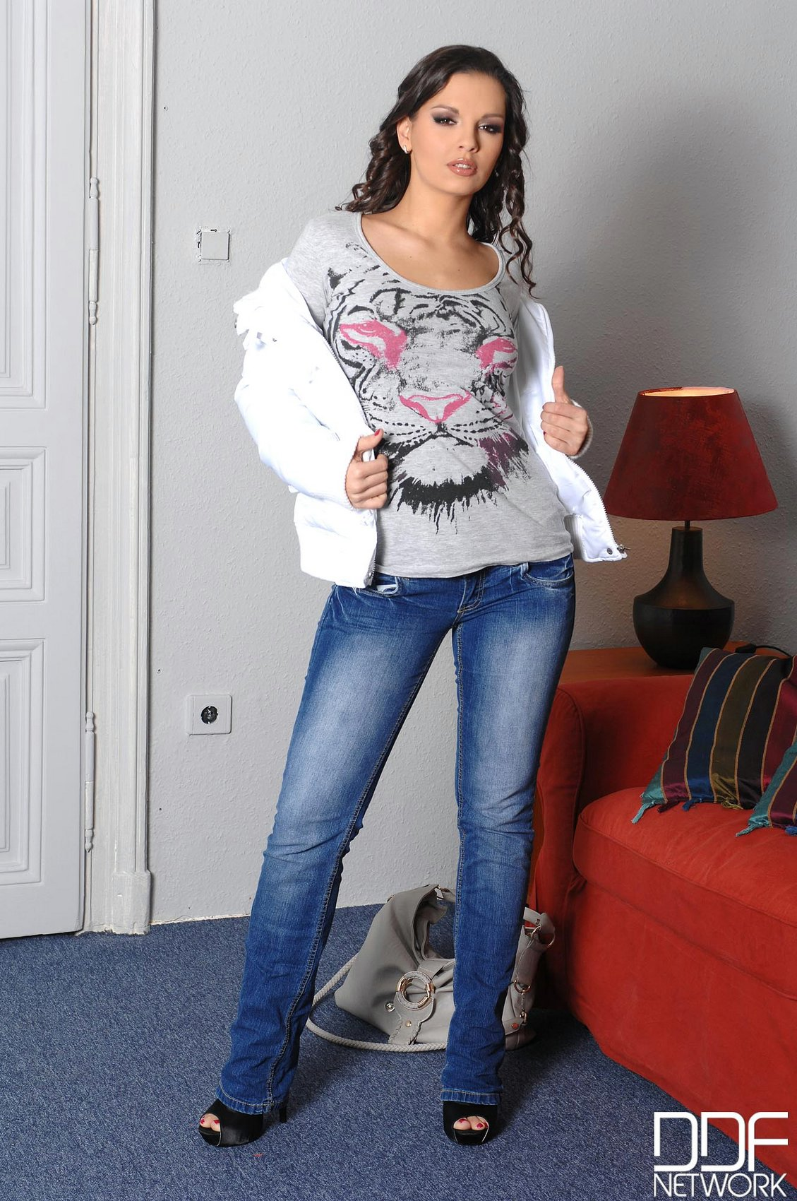 eve angel in sexy jeans posing and playing with a dildo