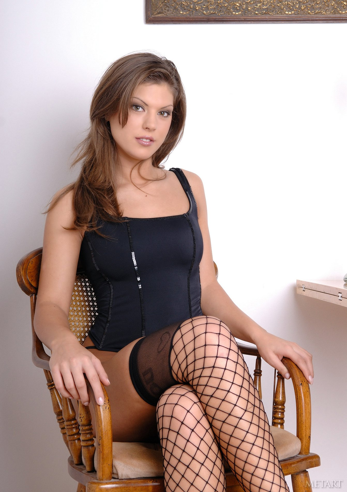 Hannah Hunter in fishnet stockings and sexy shoes poses for you.