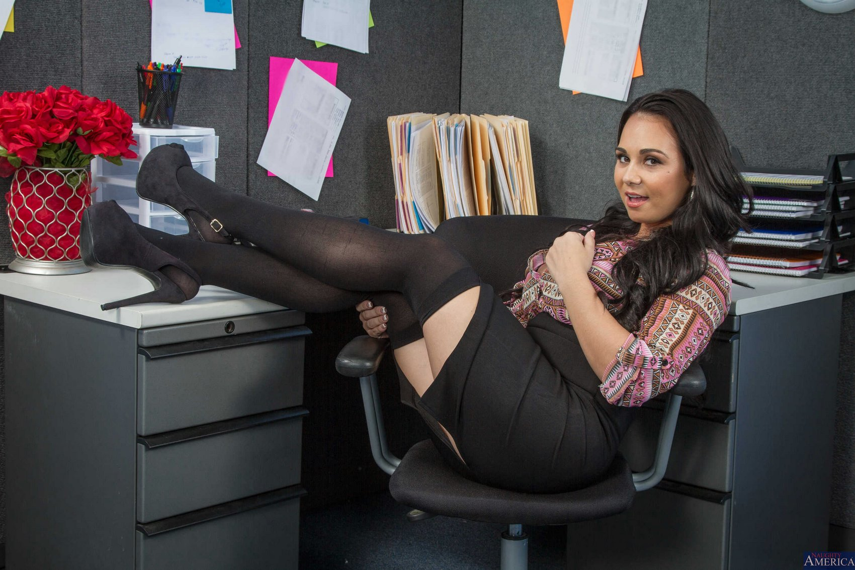 holly west in black stockings and heels posing in the