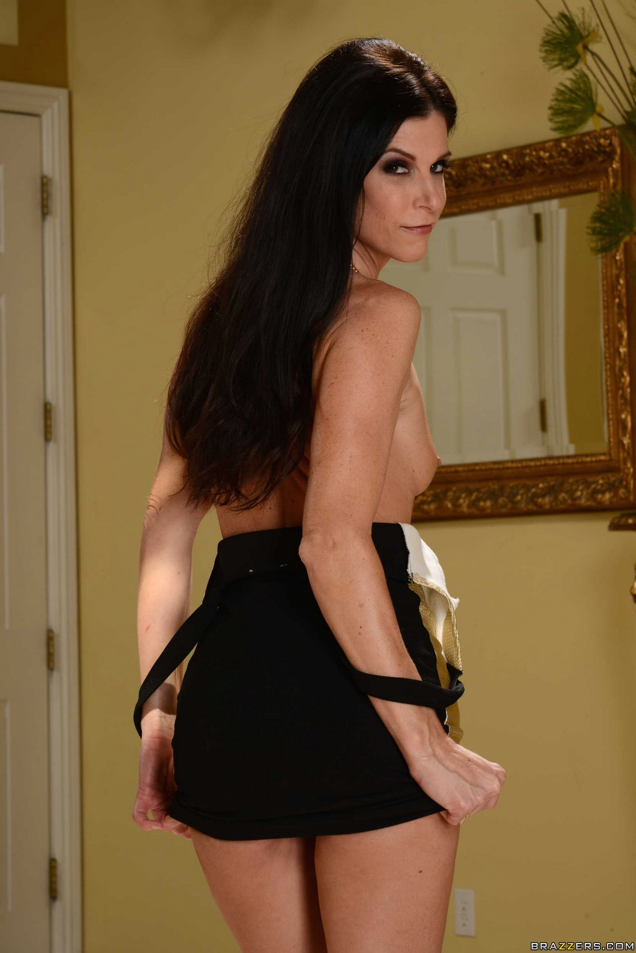 India Summer in sexy dress and shoes strips and shows her ...