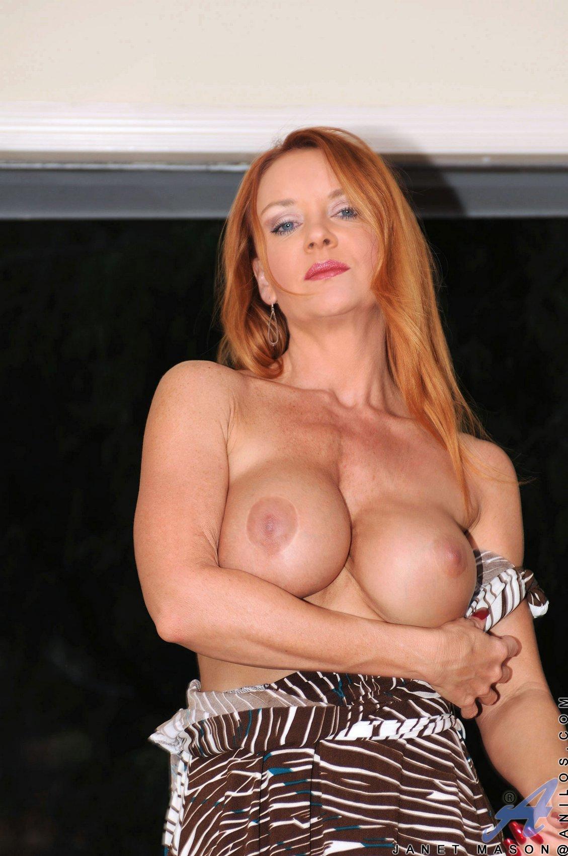 Toying redhead mature
