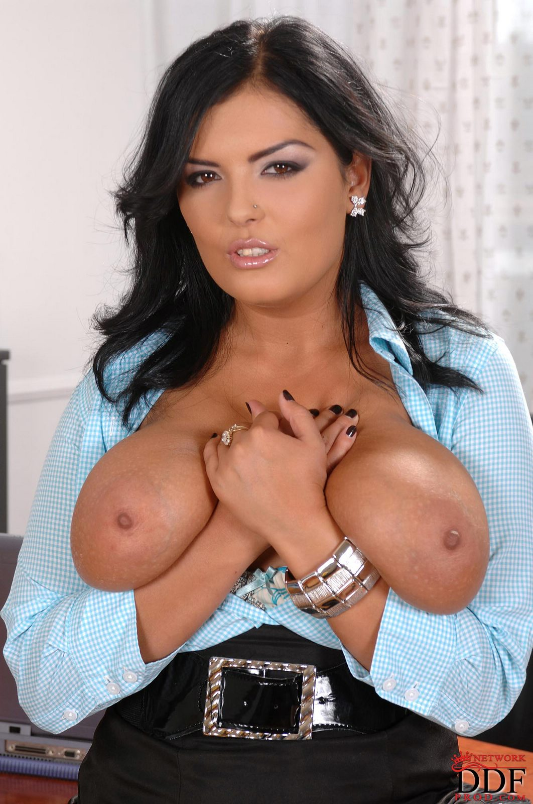 Jasmine Black stripping and showing off her huge tits in ...