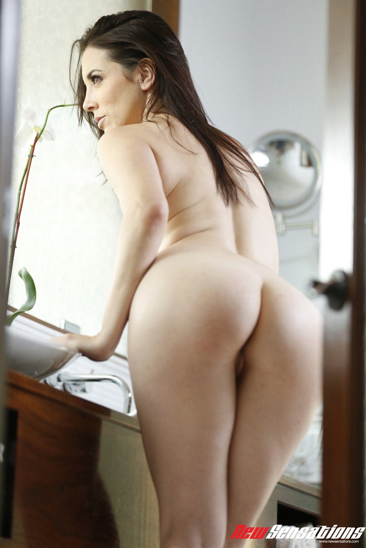 Beautiful busty brunette Jelena Jensen poses for camera ...