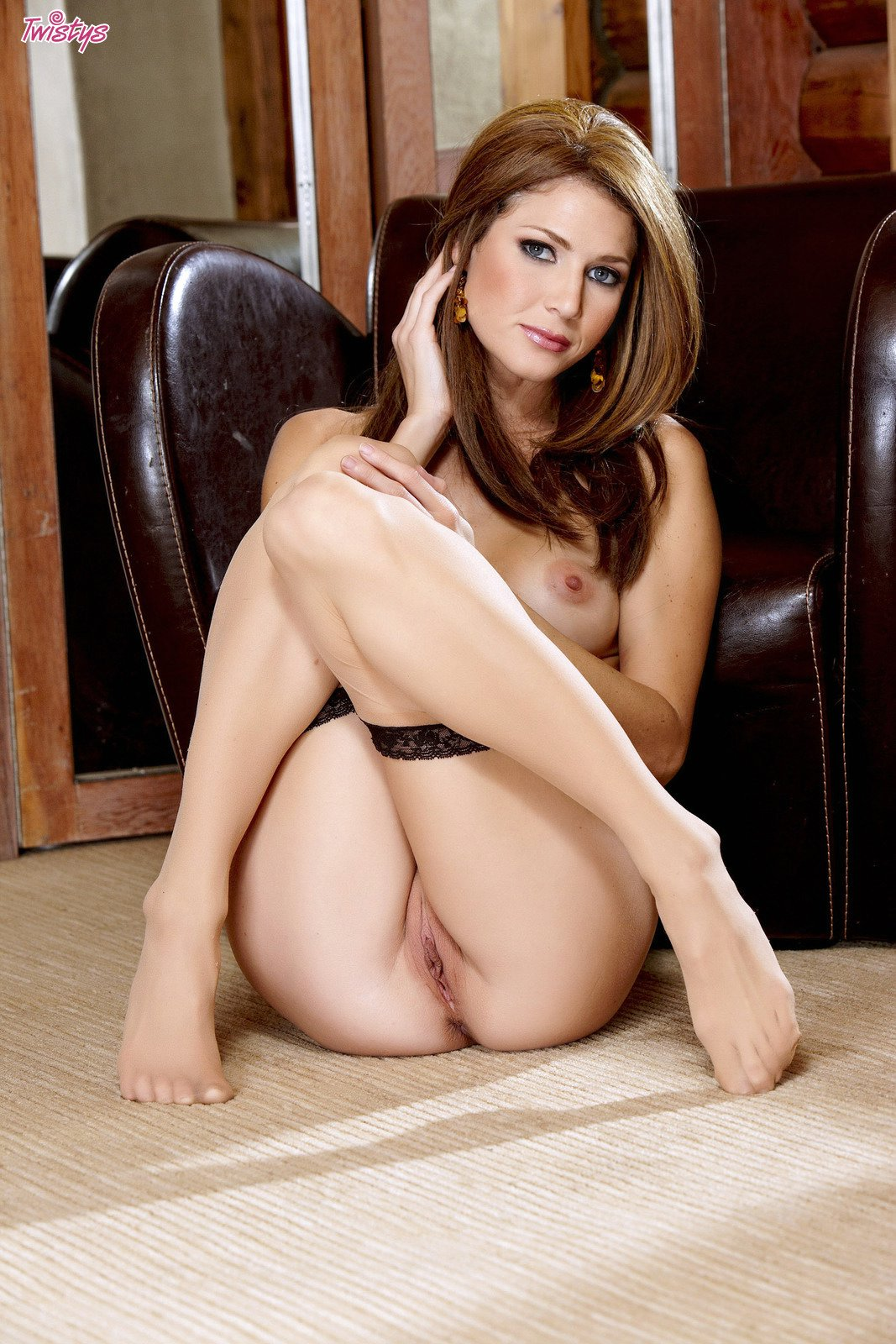 Jenni Lee in sexy stockings posing in front of the camera ...