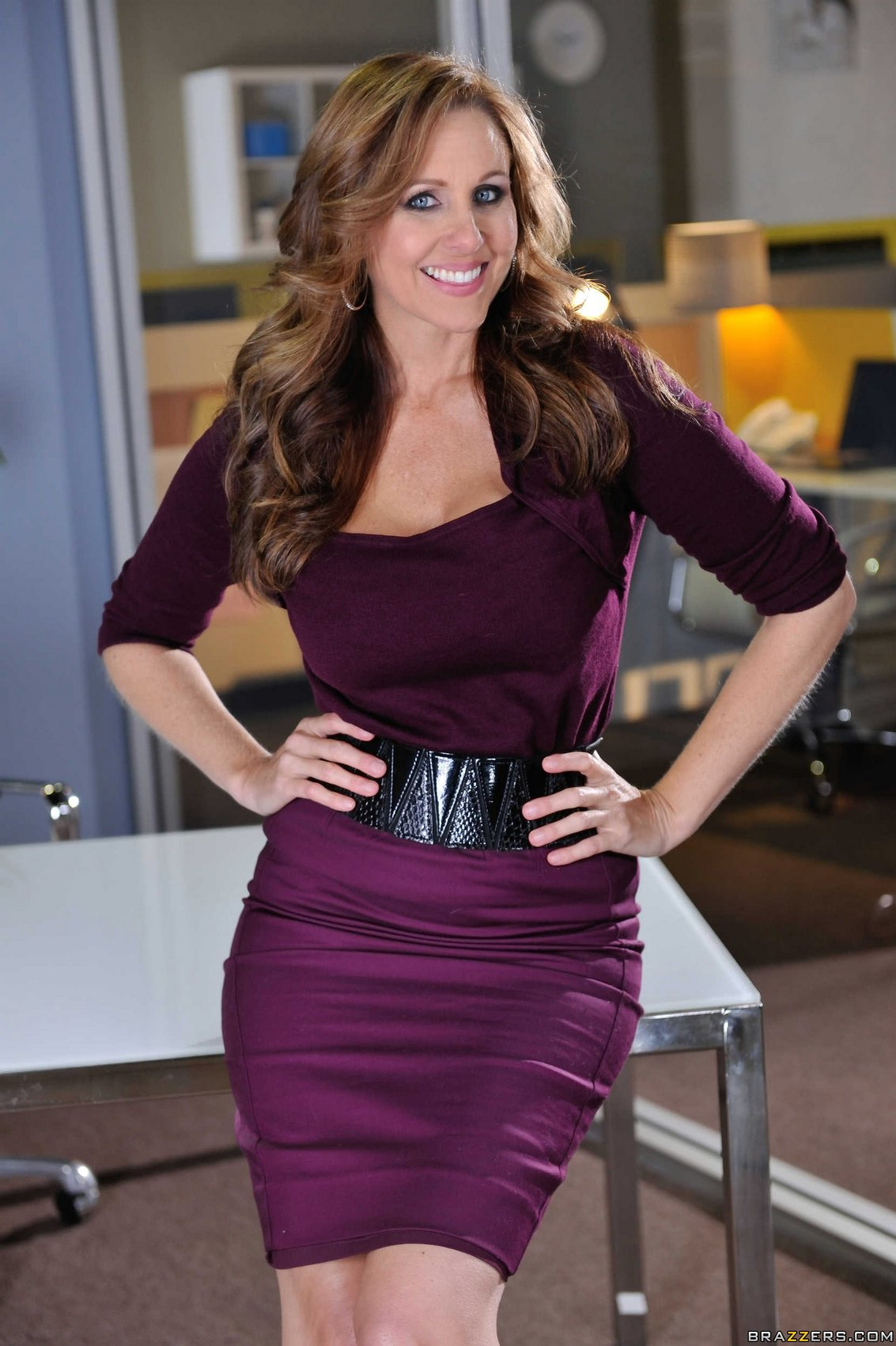 Julia Ann in sexy dress and heels posing in the office