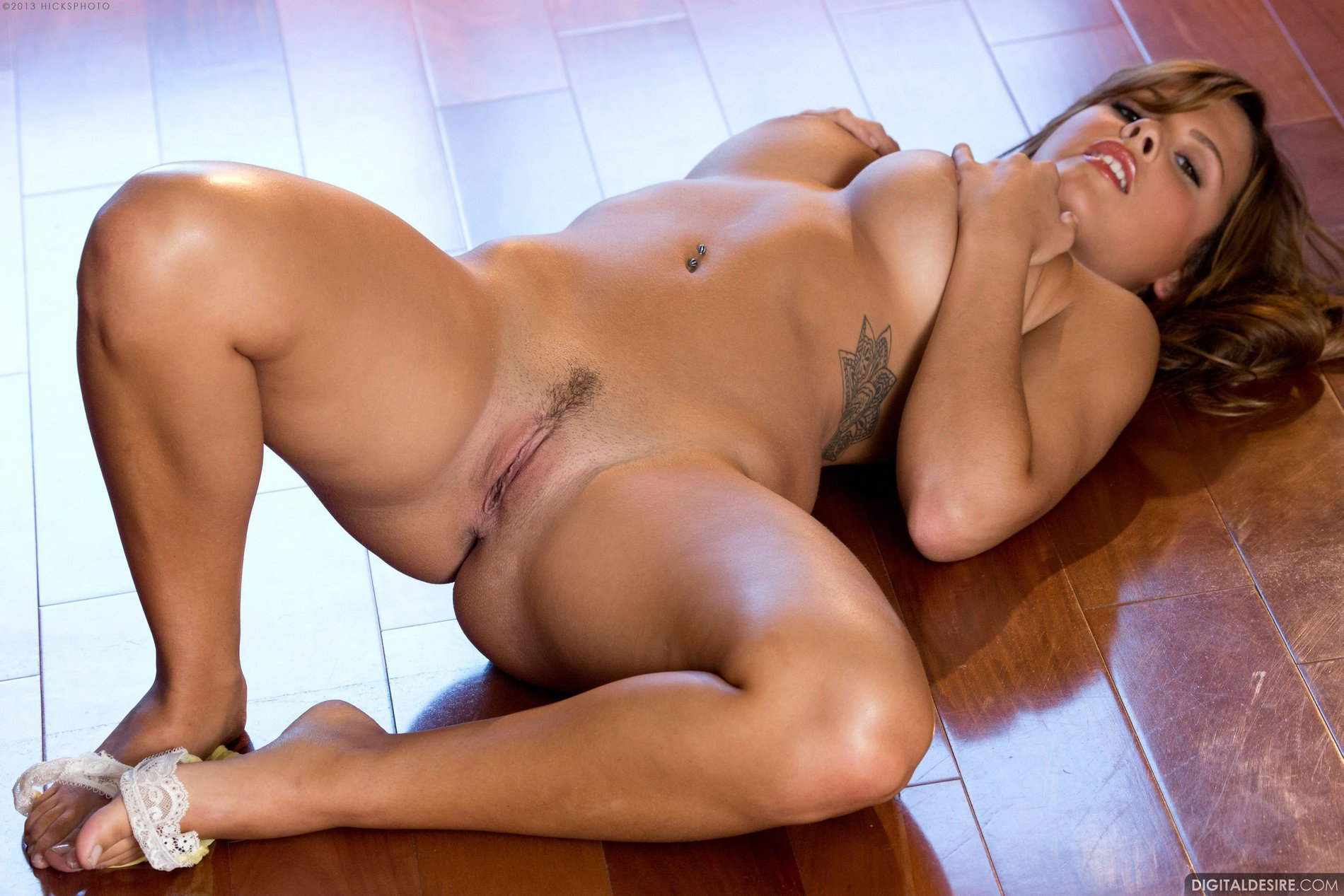 Gorgeous busty babe Keisha Grey poses naked on the floor ...