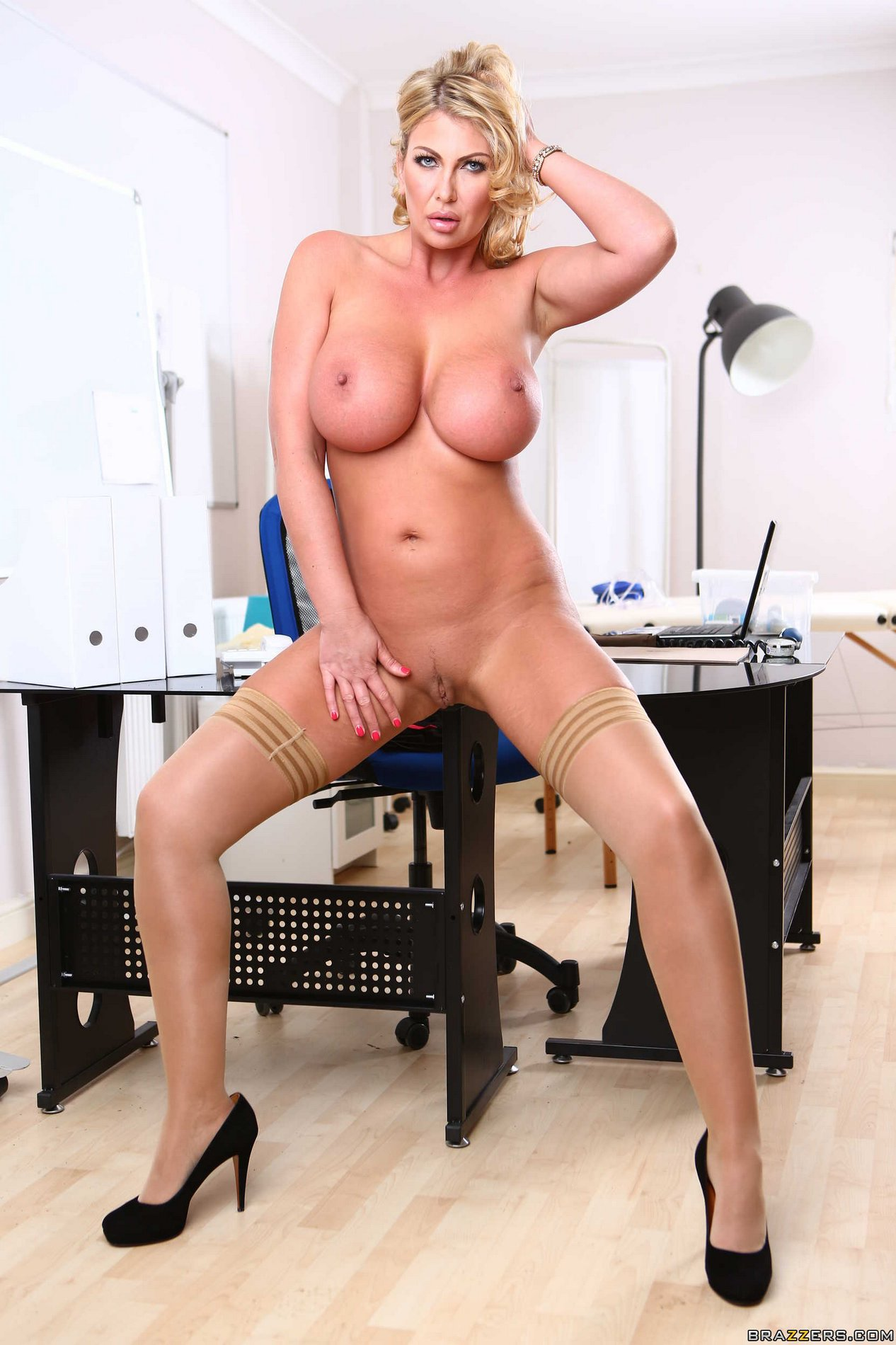 Hot busty doctor Leigh Darby strips in front of the camera ...