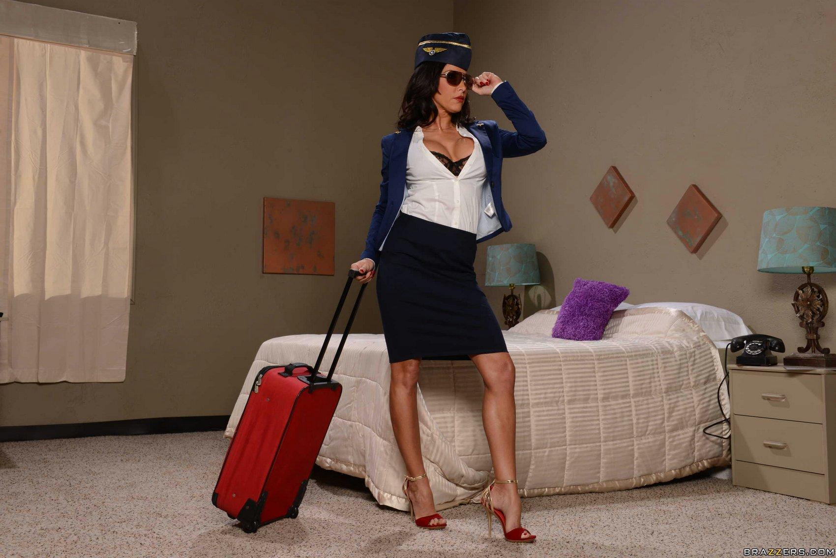 Hot Flight Attendant Lezley Zen In High Heels Posing On