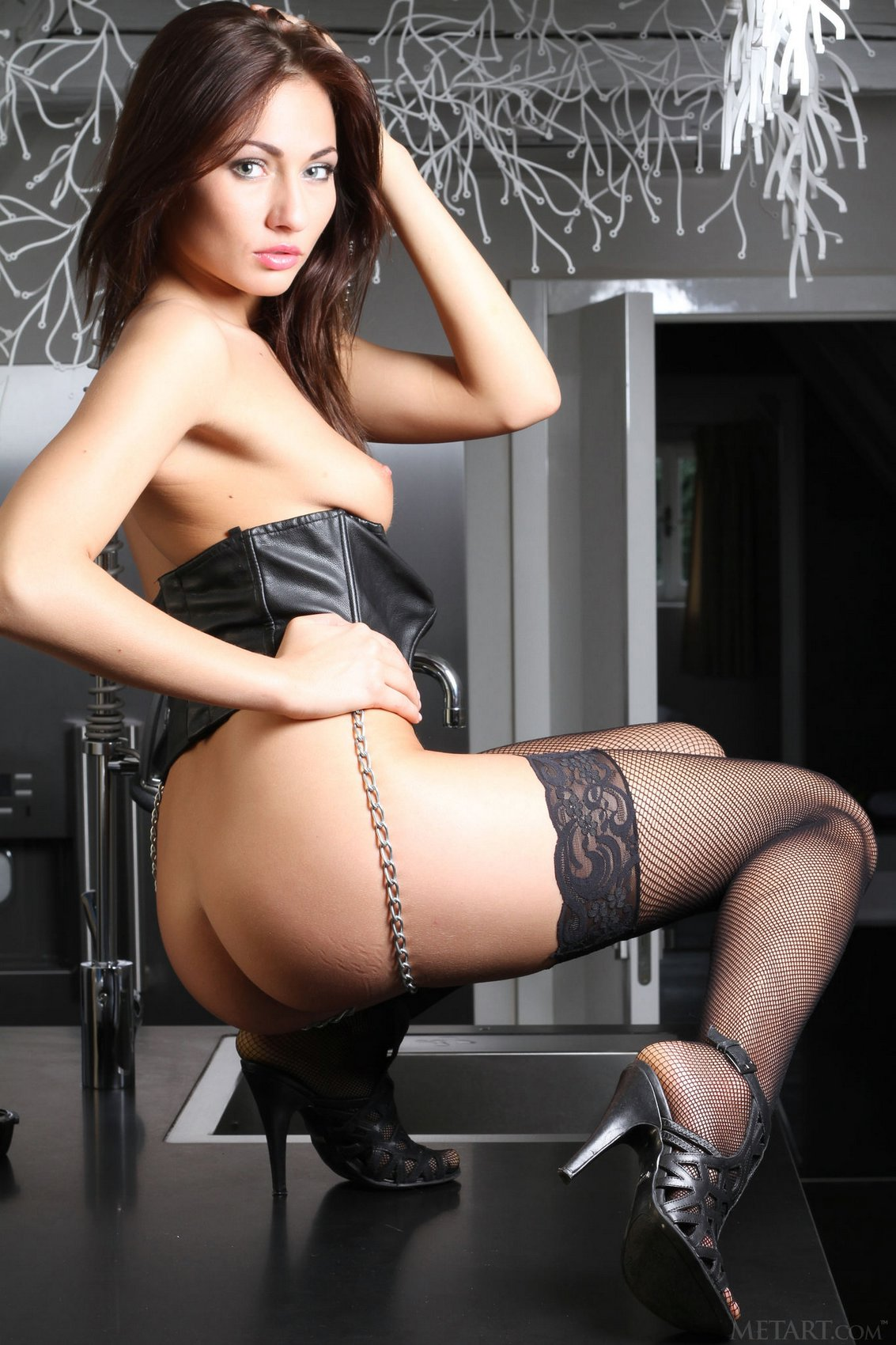 Michaela Isizzu in leather corset and sexy stockings ...