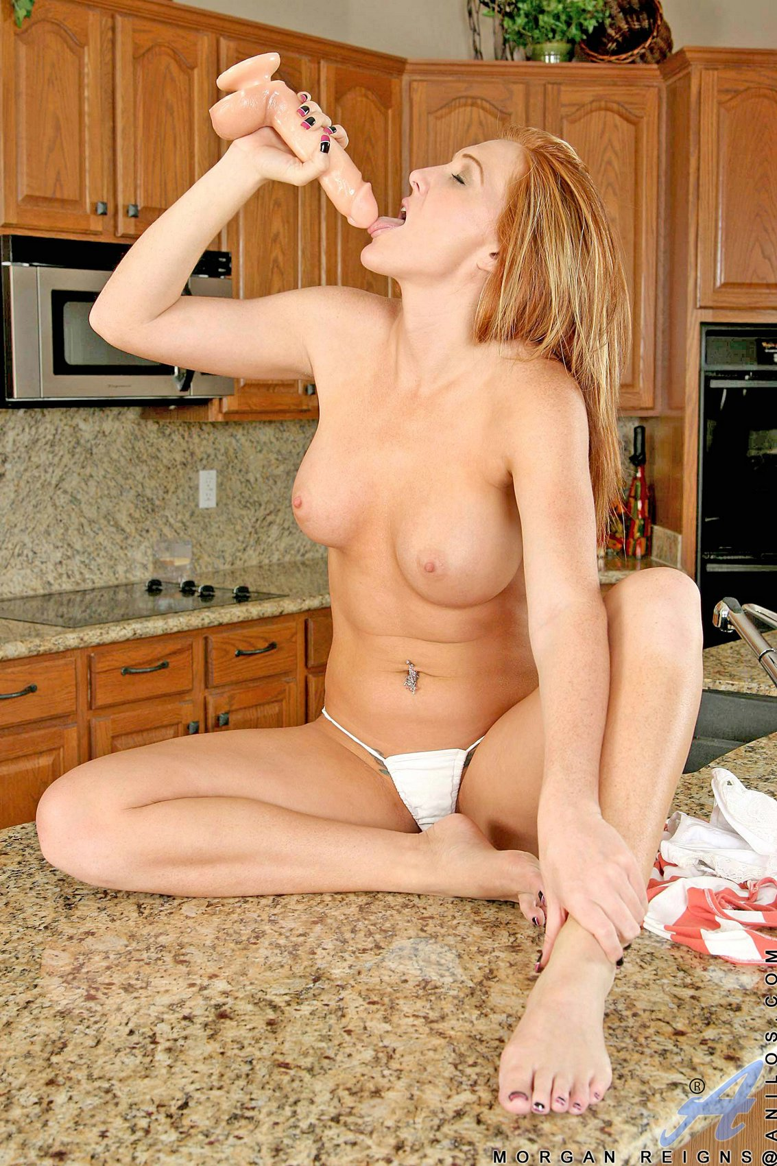morgan reigns playing with a dildo in the kitchen my