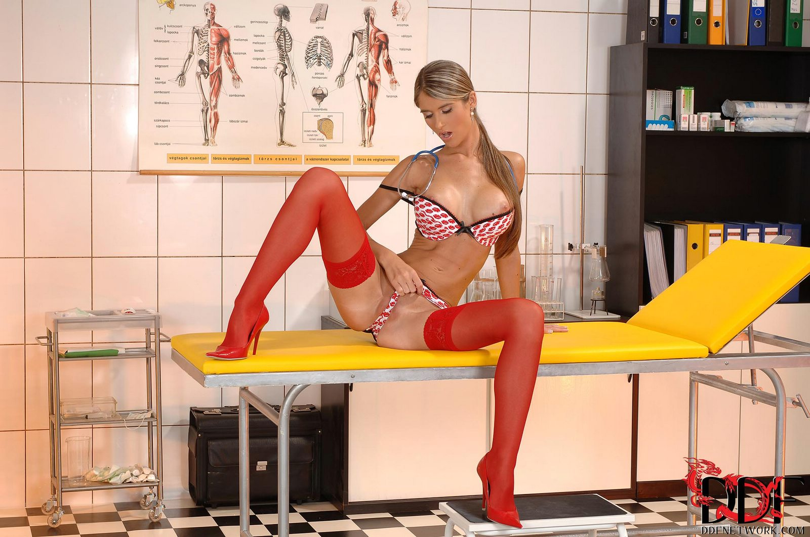 Hot nurse Nessa Devil in red stockings posing an dildoing ...