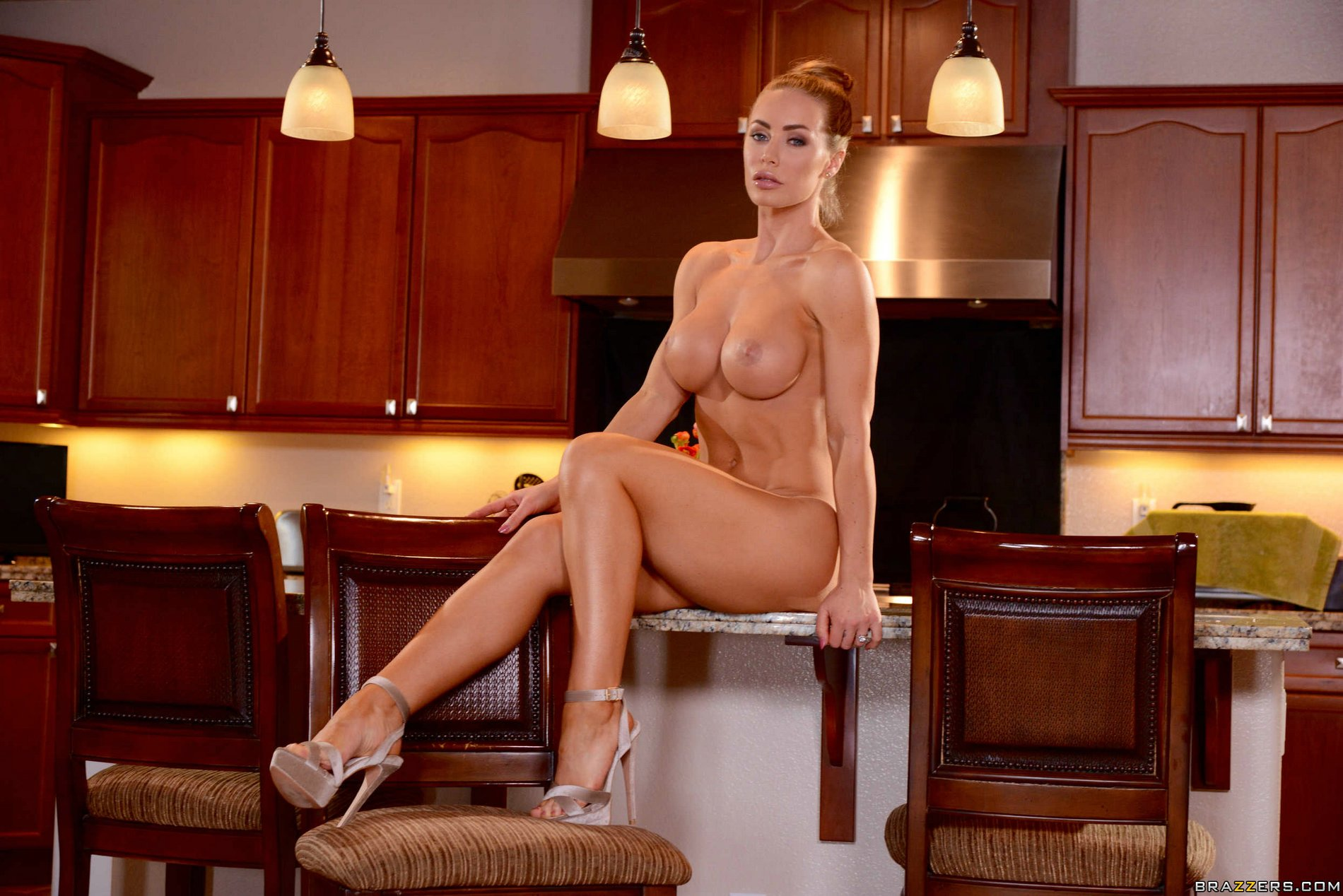 Nicole Aniston in sexy high heels strips and poses in the kitchen ...