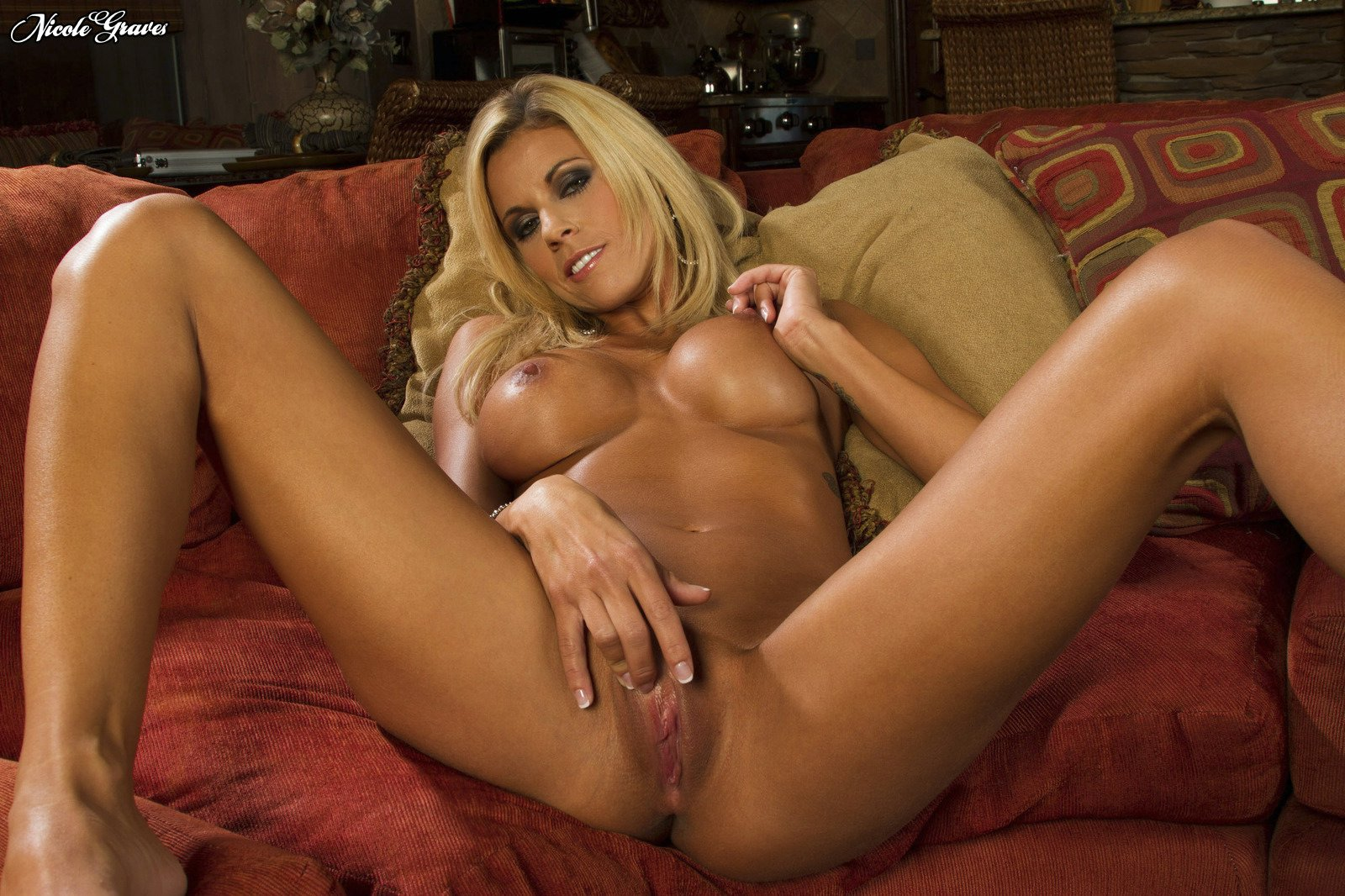 Pretty blonde Nicole Graves posing and spreading her pussy.