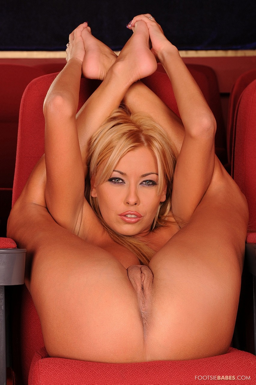 Nikky Blond enjoying hot foot fetish sex in cinema.