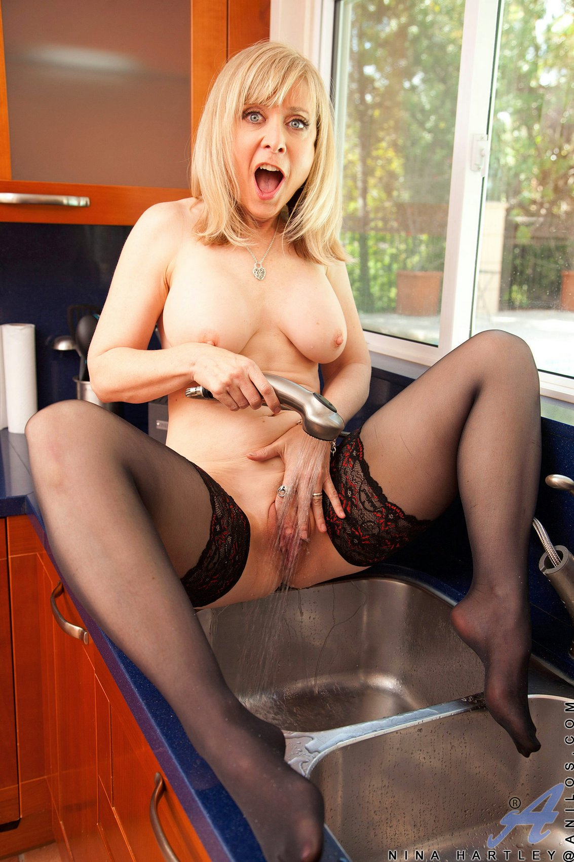 Nina Hartley In Black Stockings Masturbating In The Kitchen - My Pornstar Book-8600