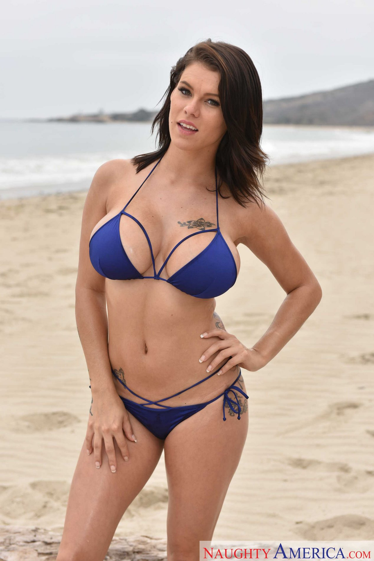 Gorgeous brunette Peta Jensen poses on the beach - My ...