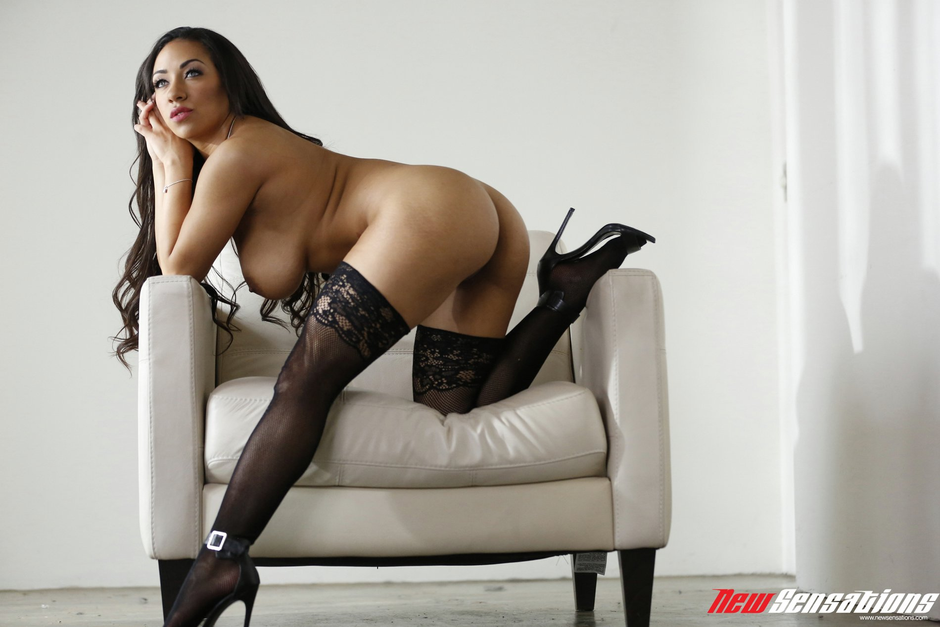 priya price in black stockings and high heels poses for