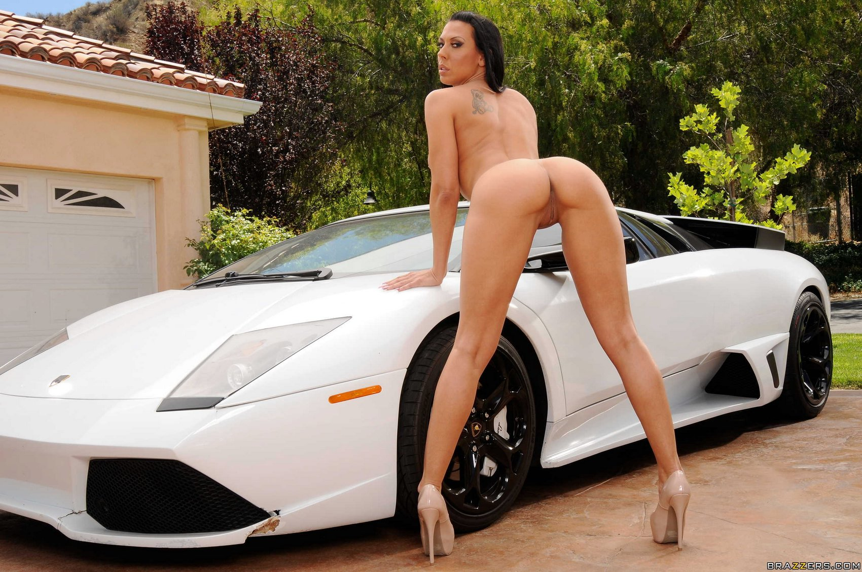 Rachel Starr in high heels posing with a sport car - My ...
