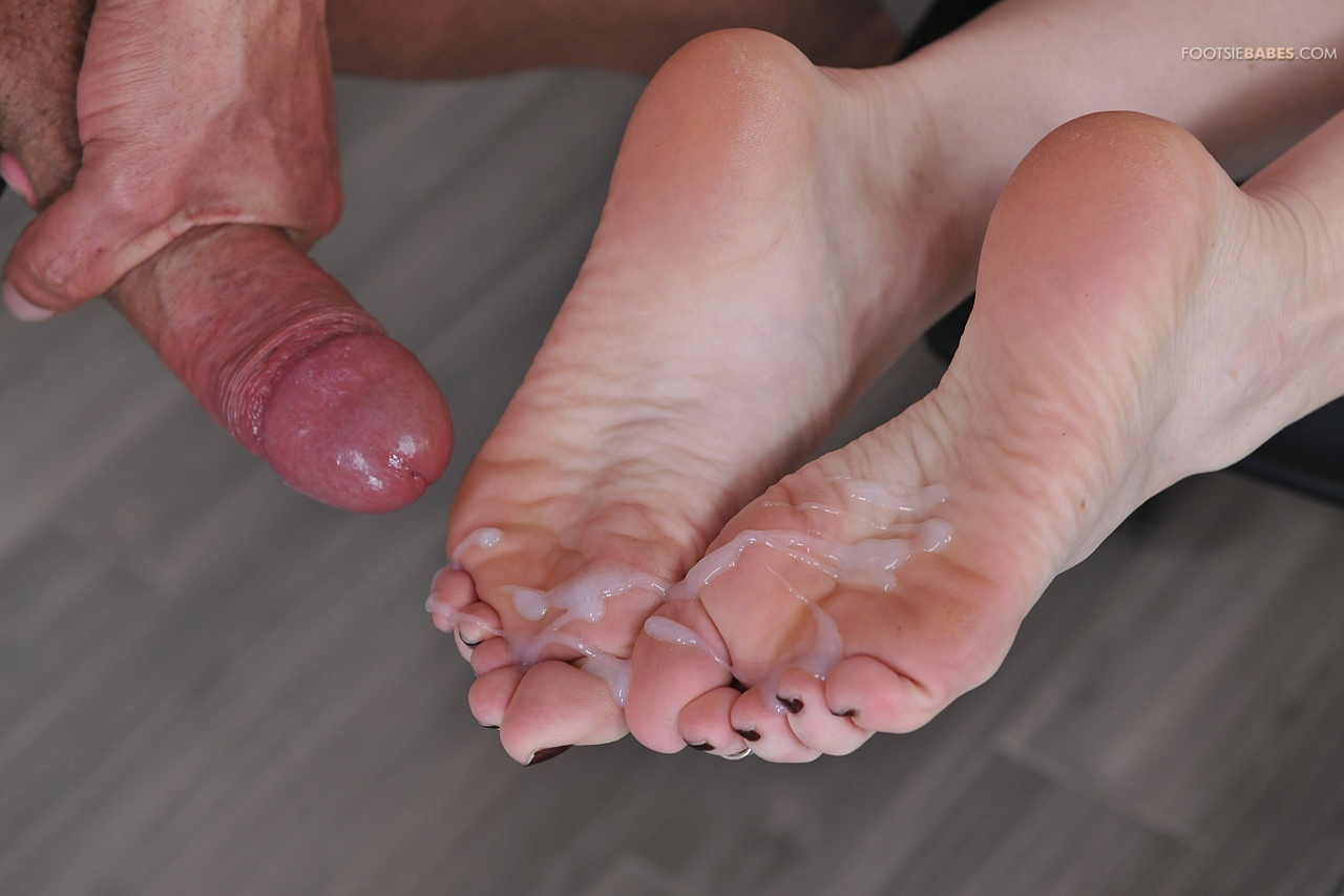Ava addams jerks cock with her feet
