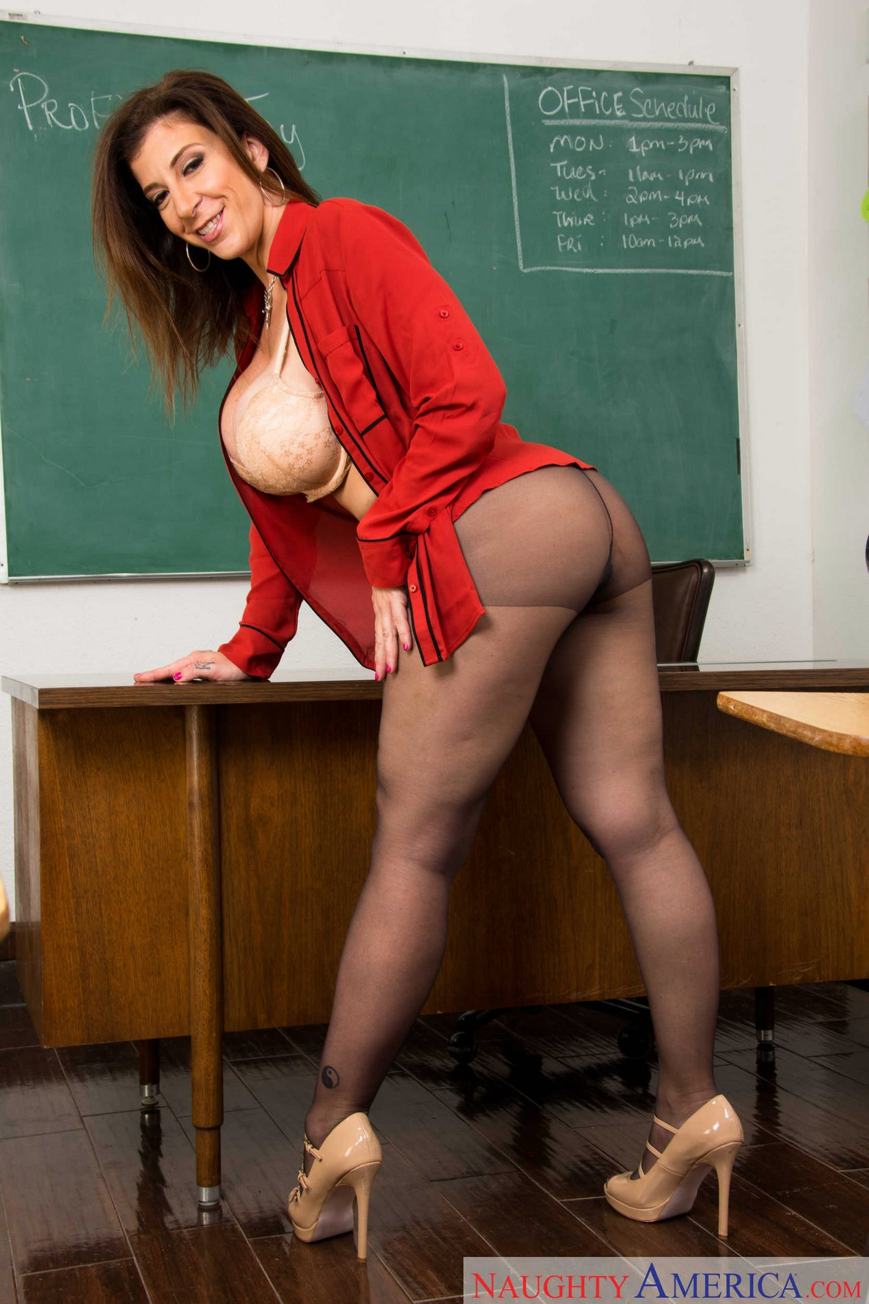 Busty teacher Sara Jay in black pantyhose strips in the ...