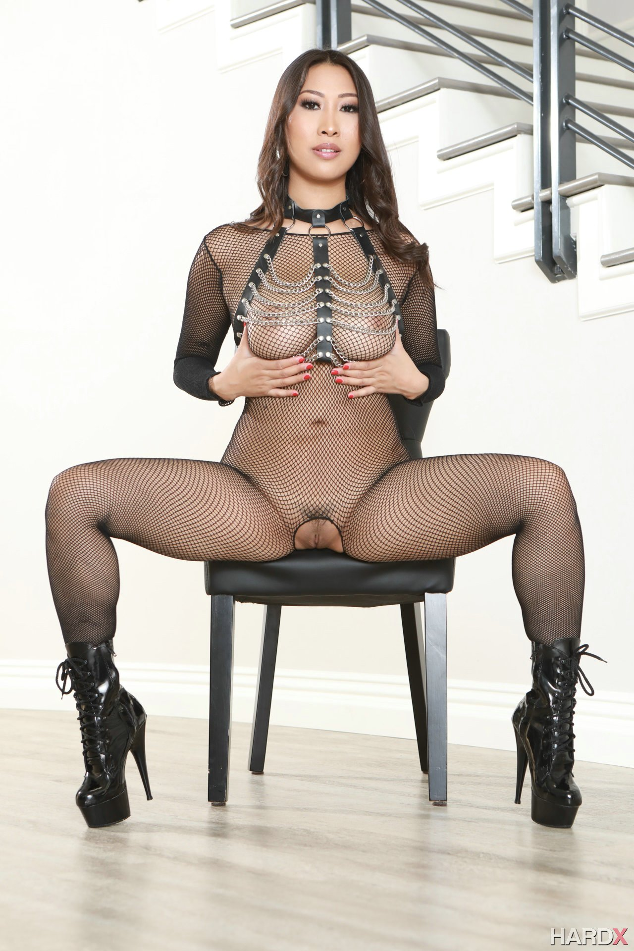 Sharon Lee in black body stockings and sexy boots exposing ...