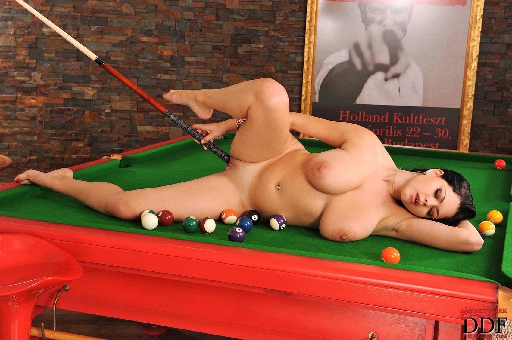 shione cooper posing naked on billiard table