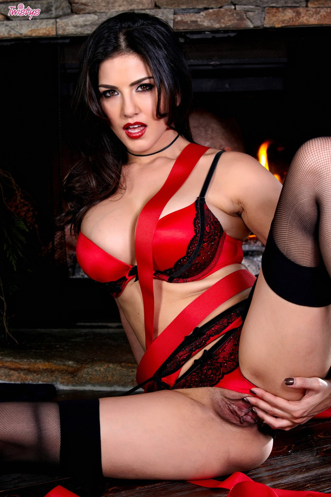 Sunny Leone in black stockings showing off her sexy body.