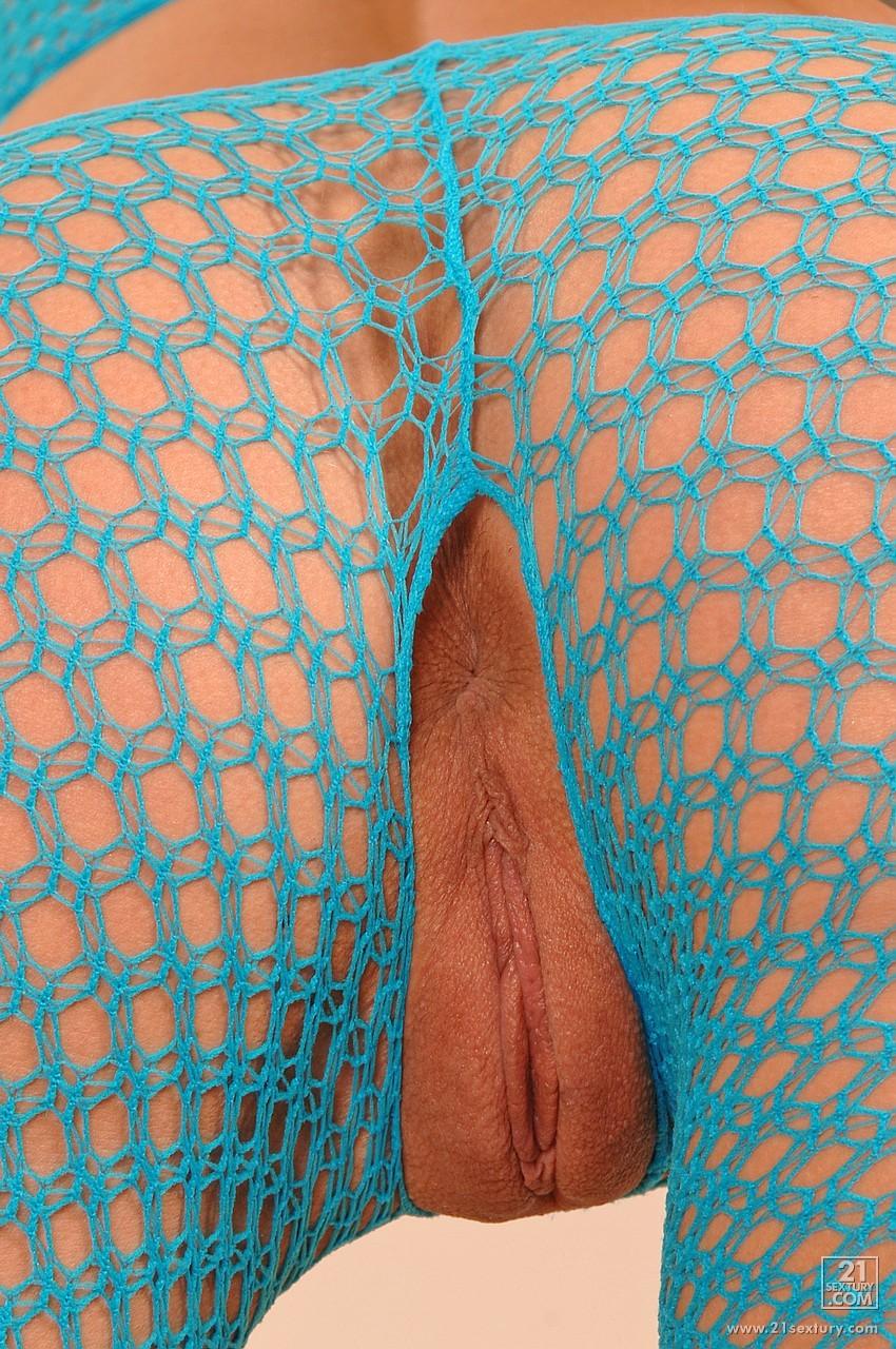 Sylvie Sinner In Blue Fishnet Toying Her Asshole