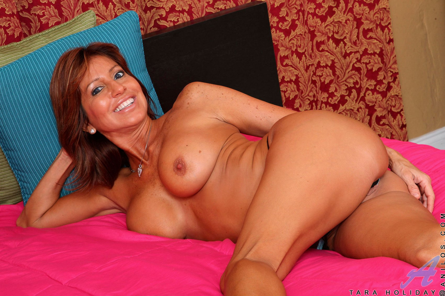 Tara Holiday stripping and posing naked on bed - My ...