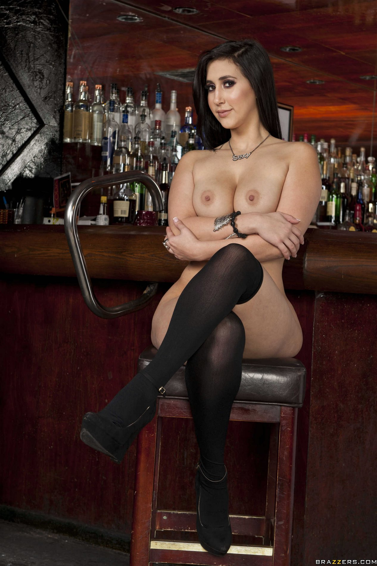 Valerie Kay in black stockings strips and poses at the bar ...