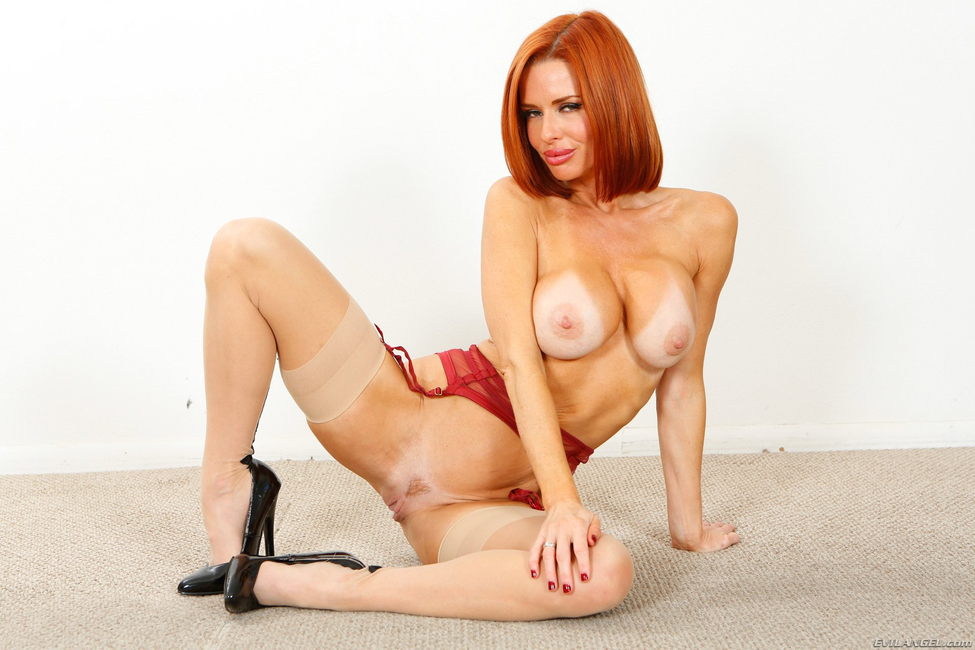 Watch milf redhead with big tits and high heels