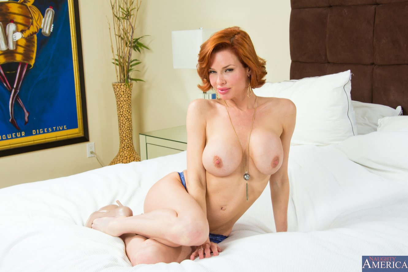 hot redhead veronica avluv in heels posing on the bed