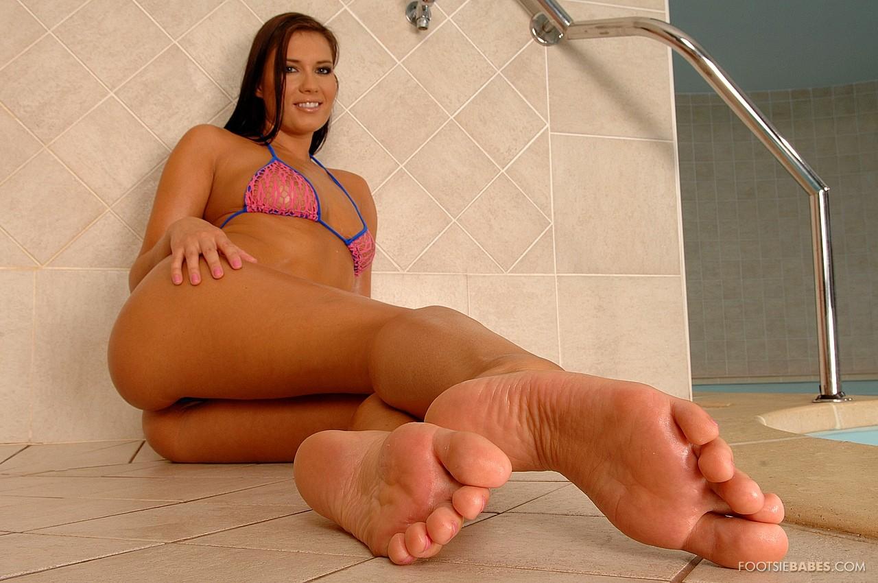 Veronica Da Souza practicing footjob with huge black dildo.